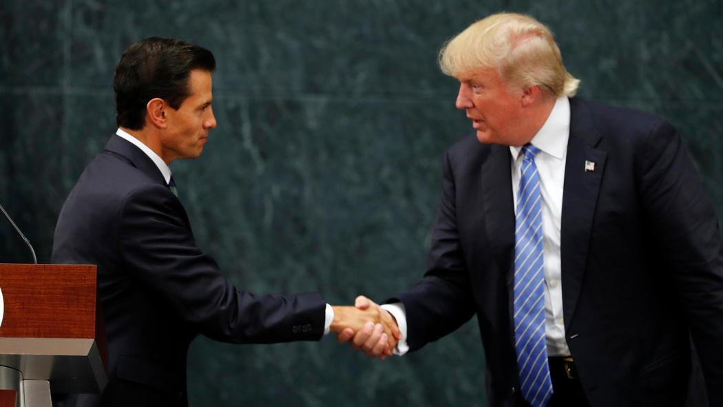 Donald Trump shakes the hand of Mexican President Enrique Peña Nieto.