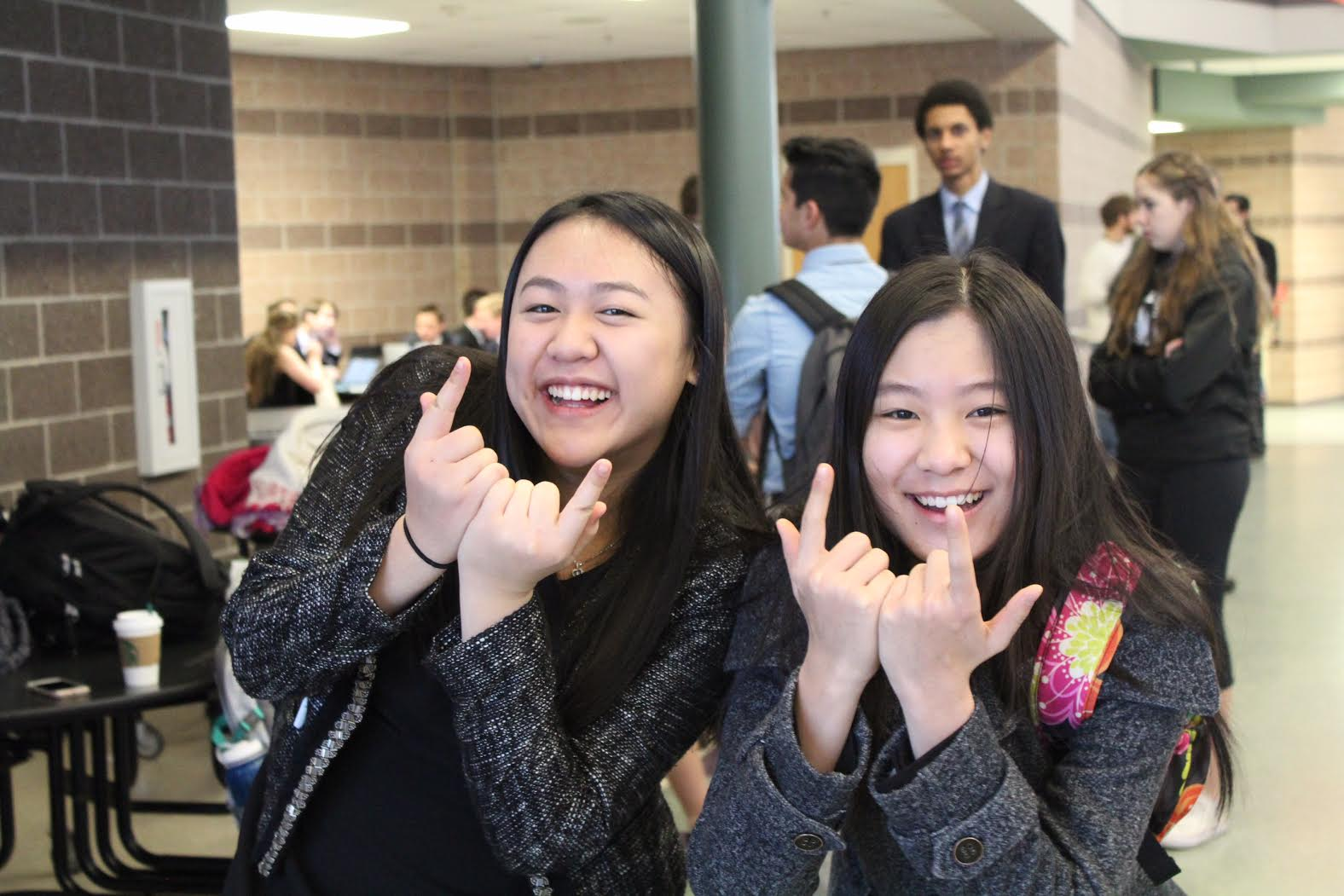 Emily Huang and Annie Chang mess around before the first debate round begins.