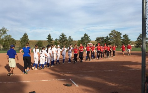 The 2015 Cherry Creek Softball team shakes hands after their 9-7 win over Castle View High School.