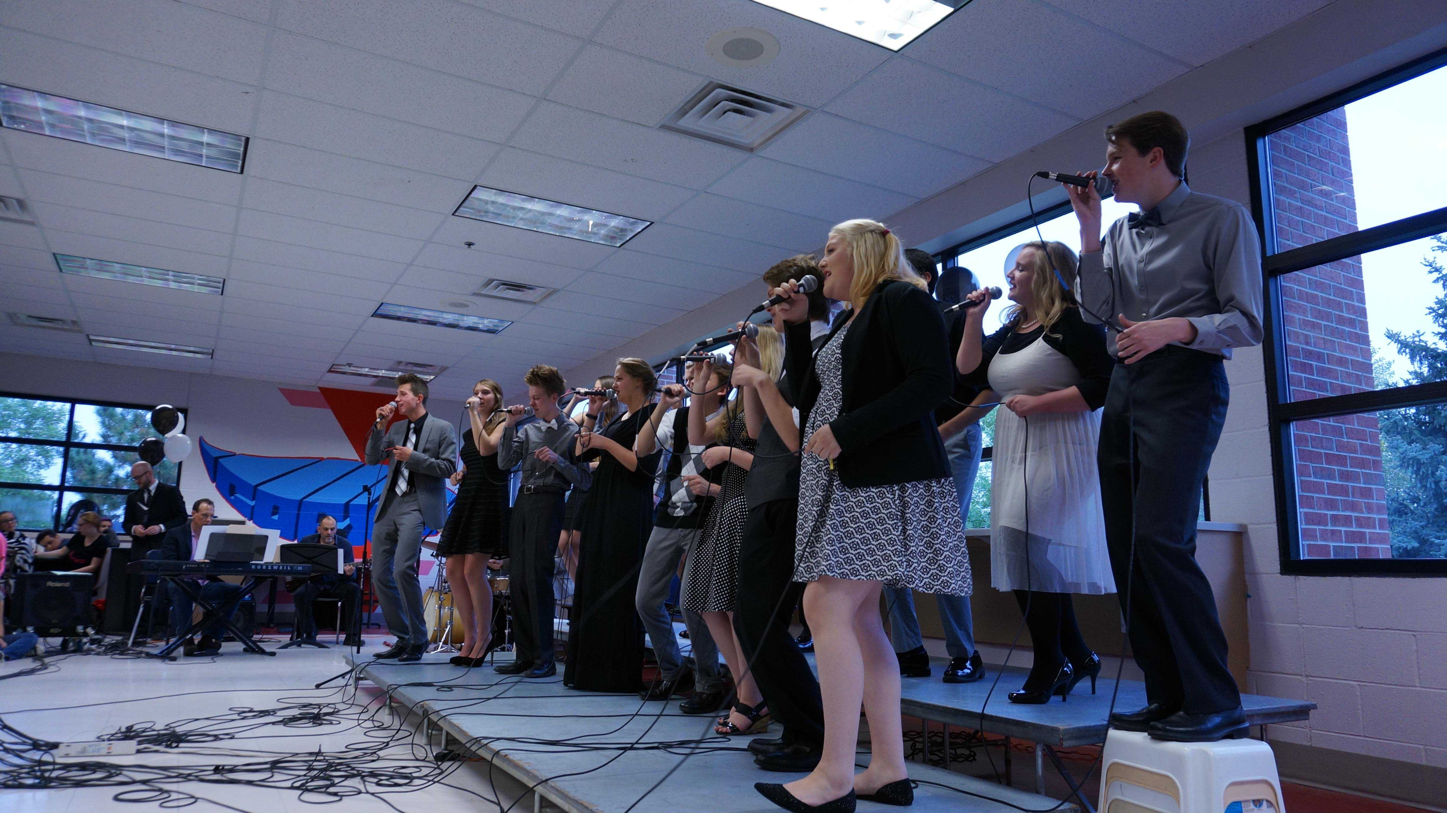 The jazz choir sings inside IC cafe during the Jazz on the Green event
