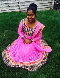 Purna Darjee sports a Nepalese cultural dress in honor of her homeland.