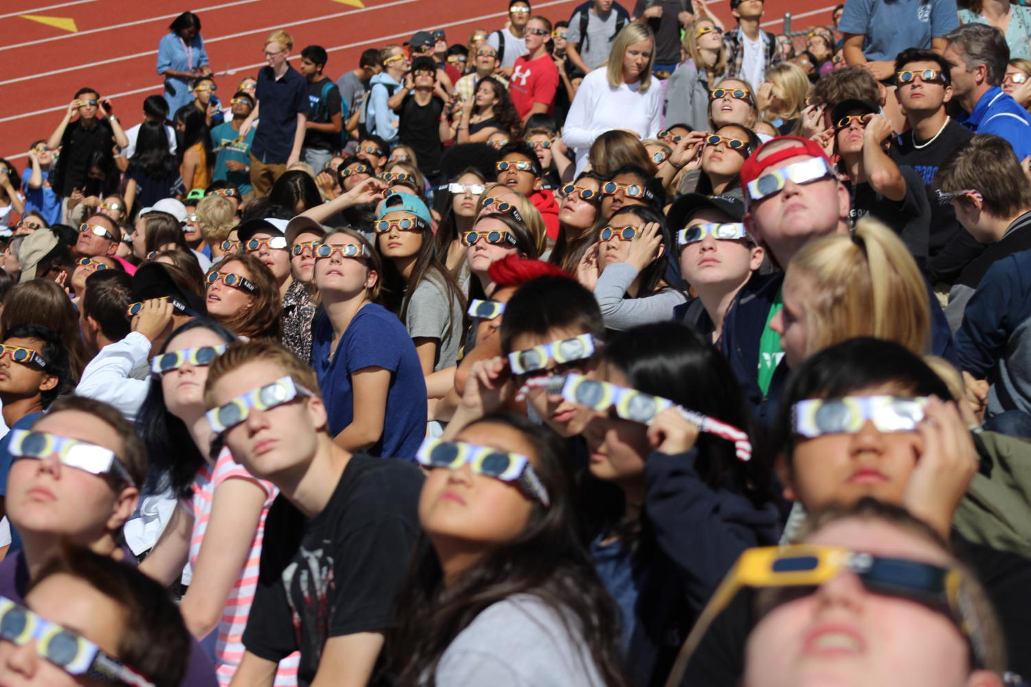Students viewed the solar eclipse with safety glasses in the Stutler Bowl on Aug. 21.