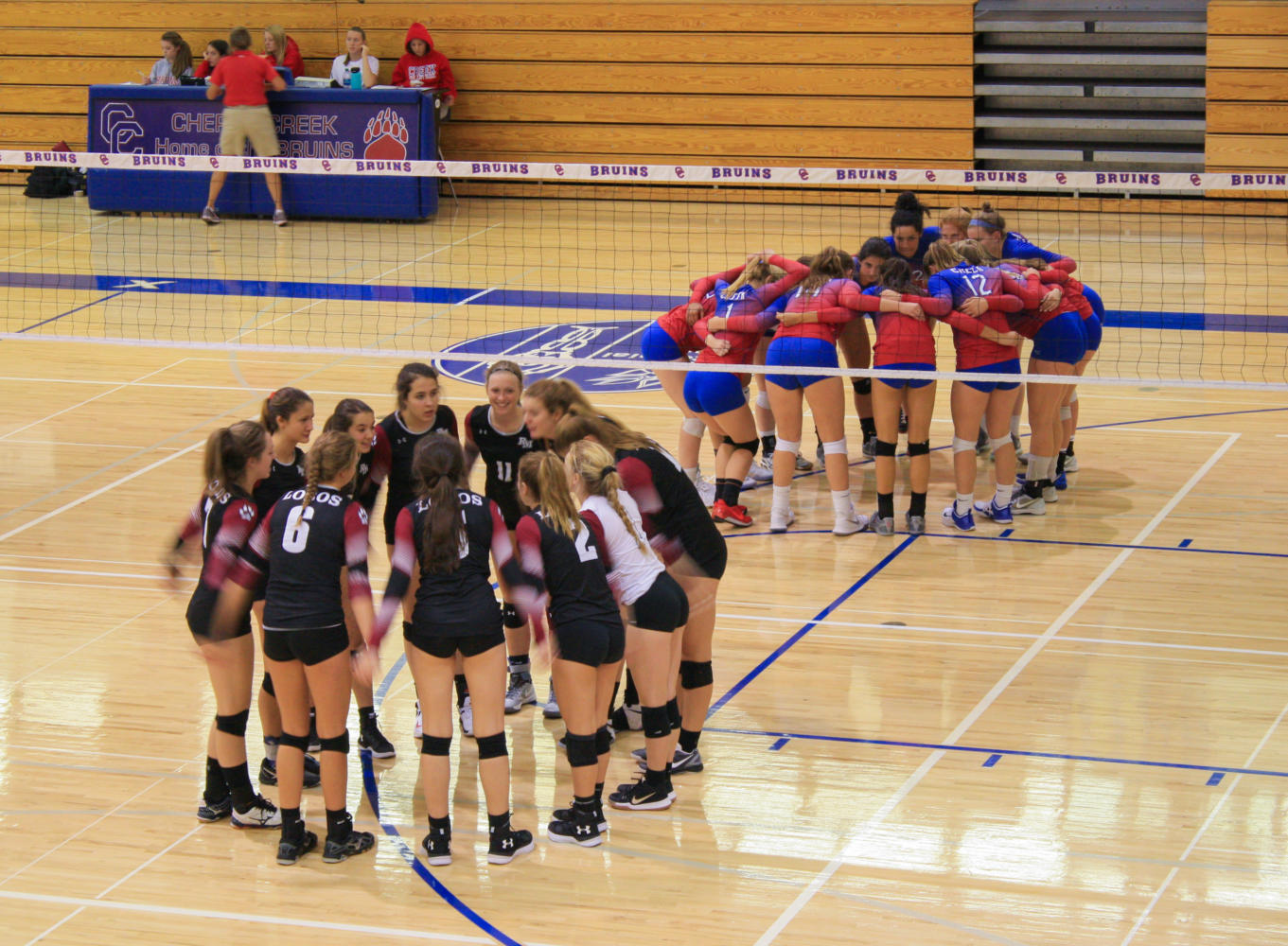 The Cherry Creek and Rocky Mountain teams gather together to get hyped before the match.
