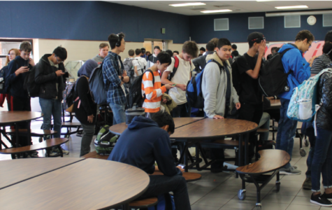 With the closing of the I.C. Café, students brave the long lines in West cafeteria during fourth period, the only source of on-campus food.