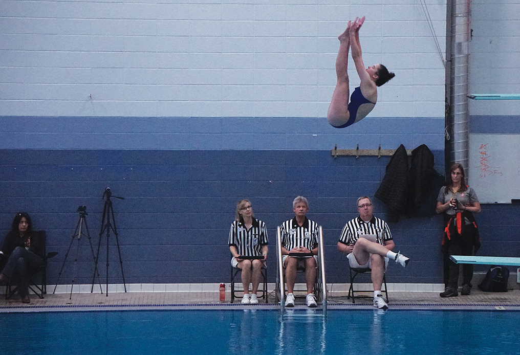DIVING IN: Sophomore Addie Perlmutter competes at State.