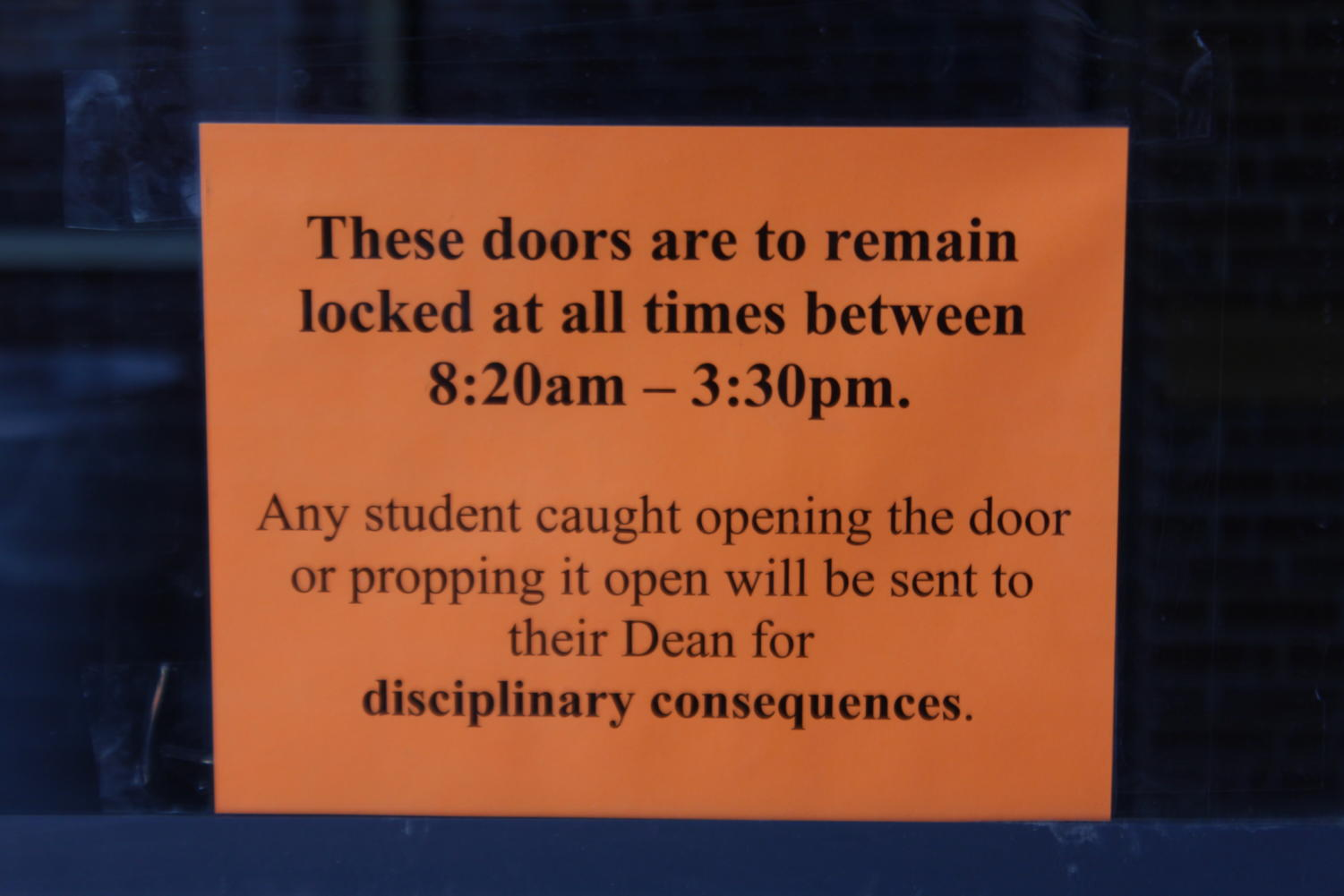 This sign is posted on various doors outside IC, Fine Arts, and West.