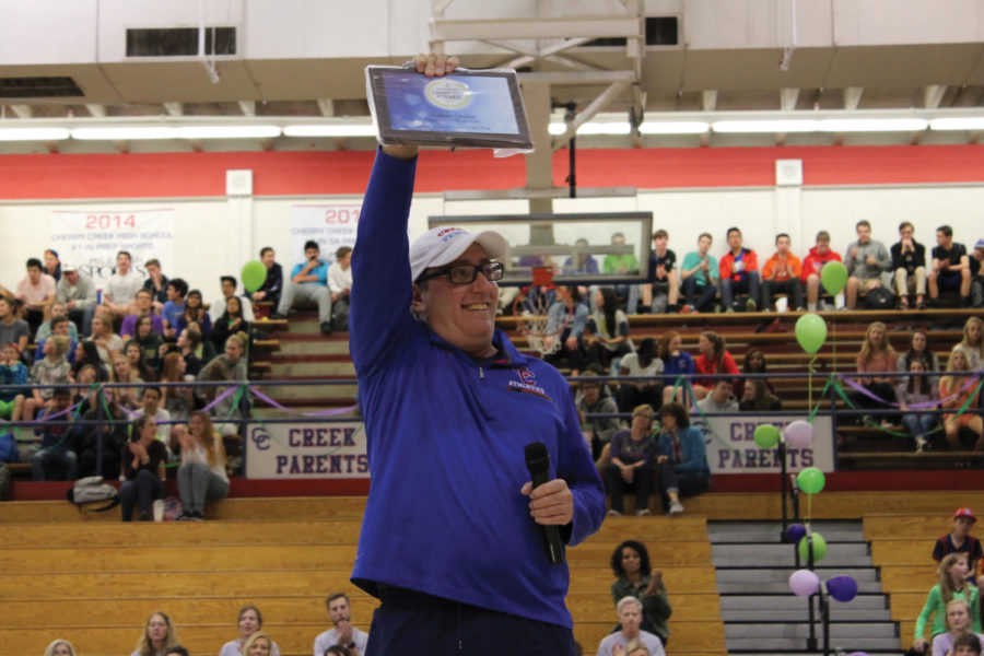 ACE: Coach Quinn received his award during the pep assembly on March 9.