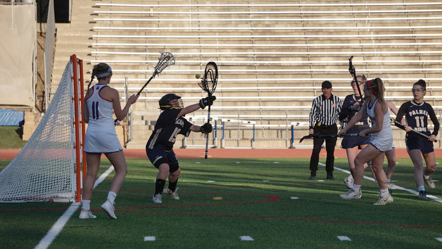 GOALS+AND+WINS%3A+Senior+Pearl+Schwartz+fires+the+ball+for+the+goal+on+March+13+in+an+18-3+win+against+Palmer+Ridge.