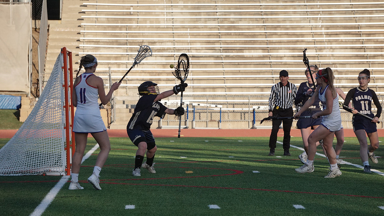 GOALS AND WINS: Senior Pearl Schwartz fires the ball for the goal on March 13 in an 18-3 win against Palmer Ridge.