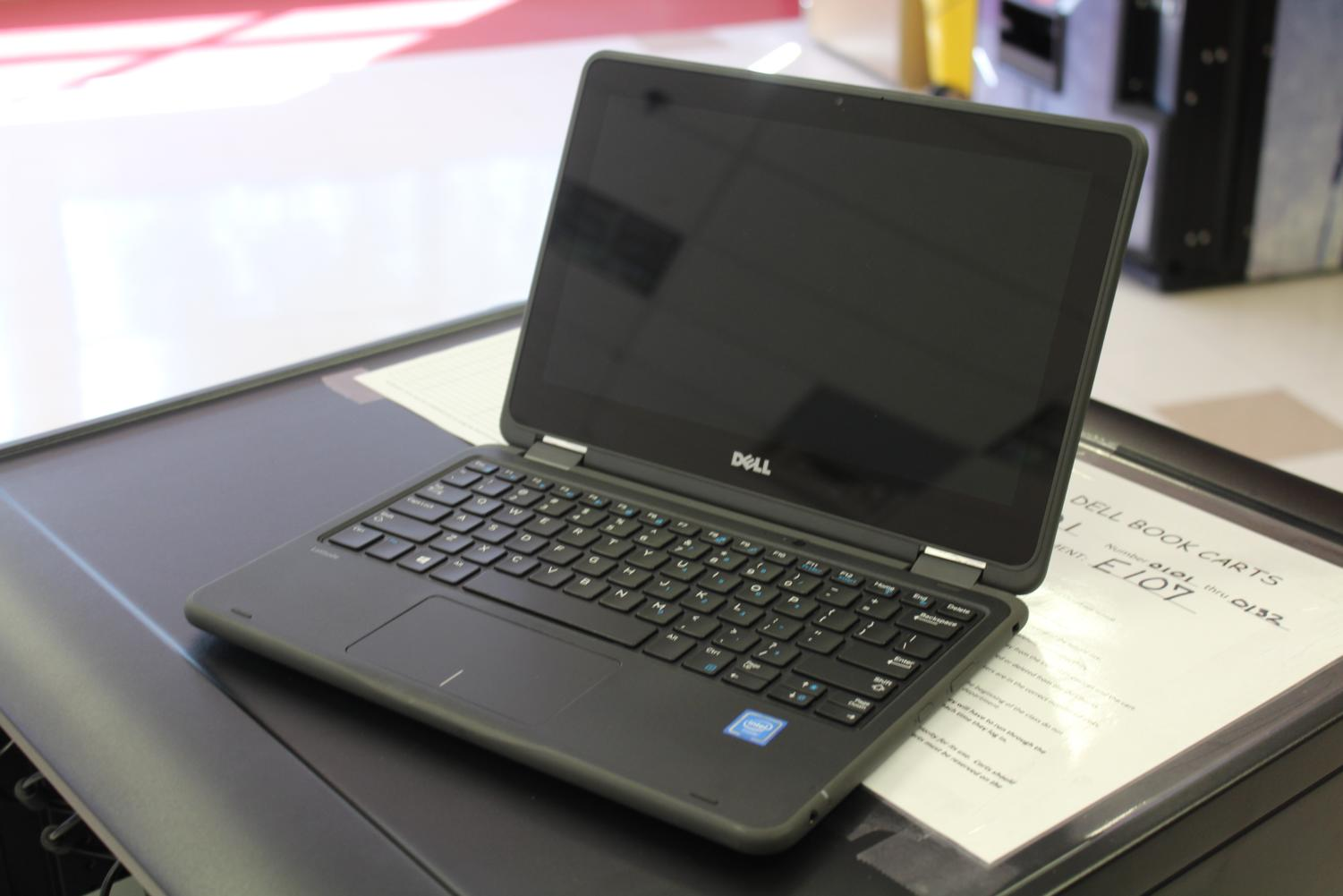The new Dell computers function both as laptops and tablets.