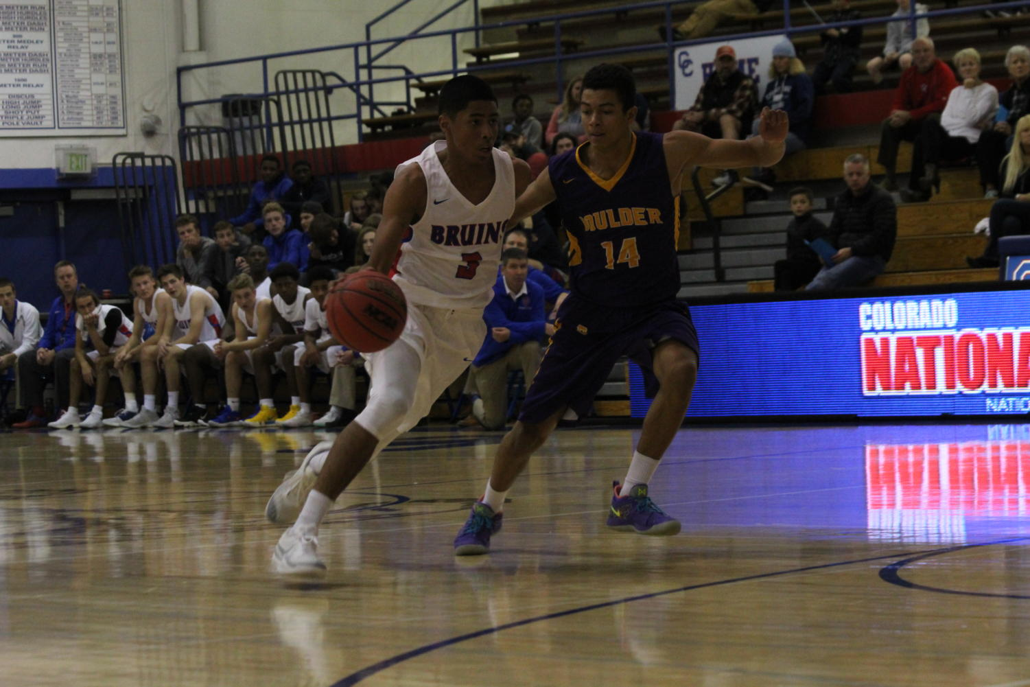 ON POINT: Sophomore point guard Julian Hammond drives to the basket during the first game of the season against Boulder on Dec. 4. Creek won 73-49. Hammond, although he's a sophomore, is a key player and starter for the team.