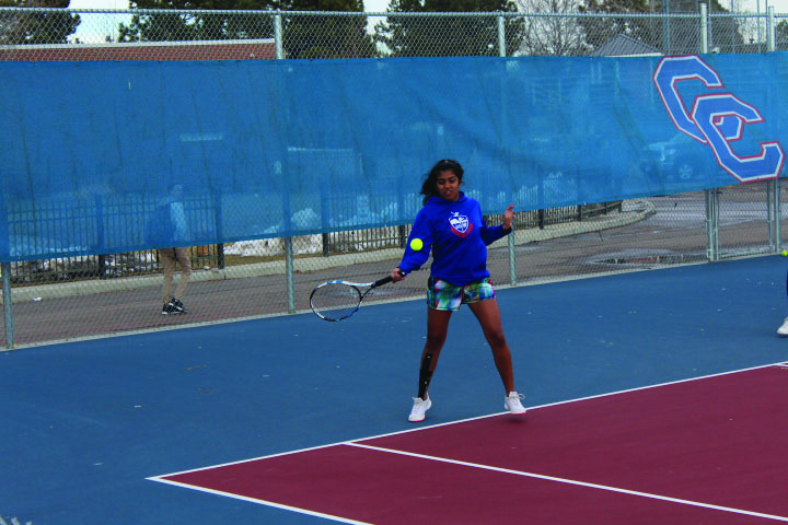 GROUND+STROKES%3A+Junior+Maya+Devarajan+works+on+her+forehand+during+practice+on+March+7.+The+players+first+challenge+will+be+against+George+Washington+High+School+on+April+3.