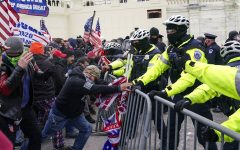 Police use pepper spray on rioters in front of the Capitol earlier on Jan. 6. These rioters were protesting the certification of November's election results by Congress. Many Creek students are furious at the actions of the rioters.