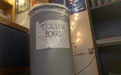 """A couple of years ago, an AP student drew this sign and put it on a trash can in Mhari Doyle's AP Language and Composition class. Many students hold the belief that the College Board is a messy organization that needs a lot of changes. The lack of subject tests and the optional essay are two very big changes for the College Board that will hopefully make life easier for high school students. """"For me at least, [subject tests] felt like one more test to stress about,"""" said junior Sirinya Frankel, who took the Spanish subject test."""