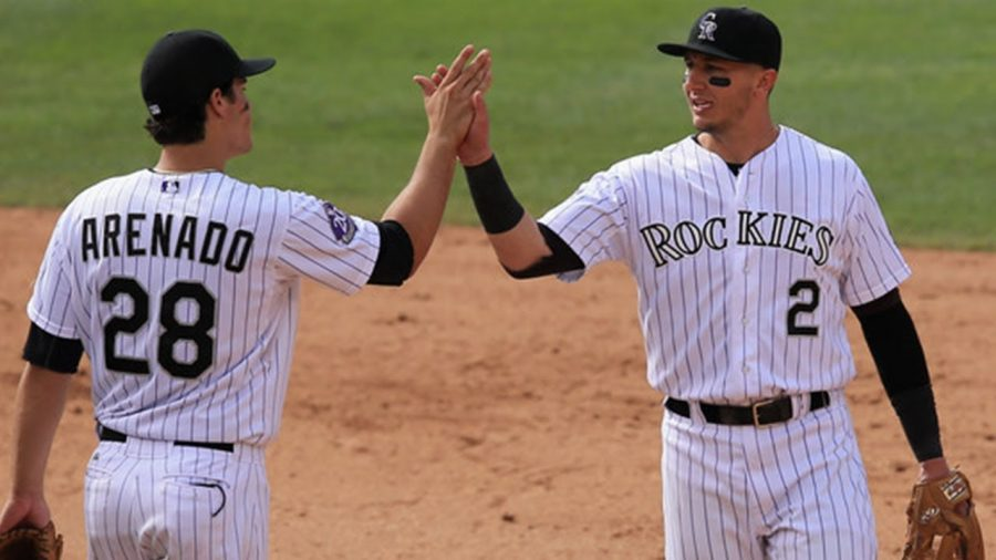 Third baseman Nolan Arenado (left) and shortstop Troy Tulowitzki congratulate each other during a game. The Rockies had what was considered by some to be the best infield in the MLB in the early 2010s. Tulowitzki was traded against his will in 2015, which has been blamed on General Manager Jeff Bridich. This angered Tulowitzki, and it angered Arenado, who considered Tulowitzki a friend and mentor. Arenado's relationship with the Rockies was never the same. When he re-signed with them in 2018, he chose to have a no-trade clause so the same wouldn't happen to him. After several conflicts with Bridich, Arenado asked to be traded. He was signed to the St. Louis Cardinals this weekend.