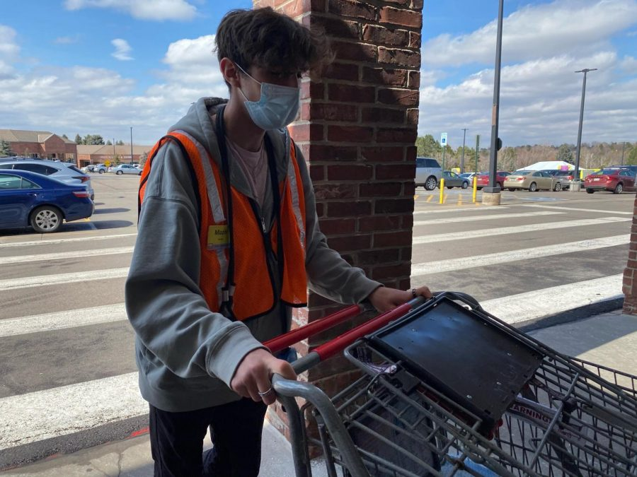 PUSHING CARTS: Courtesy Clerk Mazin Klapperich brings in carts at King Soopers store 096. On the busiest days, such as Sundays, clerks bring in up to 15 carts at a time. Klapperich also expressed sorrow for those killed at the Boulder King Soopers on Mar. 22.