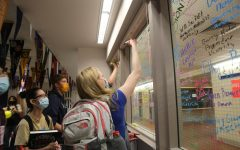 LEAVING THEIR MARK: Seniors complete annual traditions such as signing the windows in Post-Grad, pinning maps with their college decisions, and picking up yearbooks. For seniors such as Anjali Kurse, leaving Creek brings hope and opportunity.