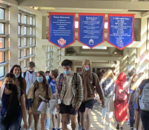 Students crowd IC Tunnel after school Friday. CCSDs mask policy, taken directly from Tri-County Health Department, states that masks are required at all times while students are indoors. However, many students take off their masks once they leave classes, often walking maskless through the halls. Some students think the vaccine affords them enough protection that they dont have to wear a mask any more, while others find masks uncomfortable or not worth the trouble. Whatever the reason, enforcing masks has been difficult at Creek.