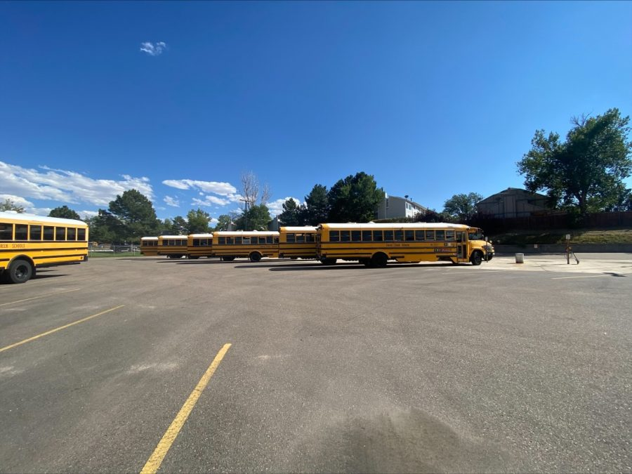 """Sitting Ducks: On any given day, not all buses at Creek get utilized due to the nationwide driver shortage. Nine buses sit in the west parking lot before school ends. Hopefully some of these will be driven away within the hour; however, many won't be, because there aren't enough drivers to use them all. """"We have 40 open routes across the district, which would be why some of those buses are sitting in the lot,"""" Thompson said."""
