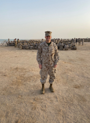 A Strong Representative: Clark stands proudly on Qatari soil in front of a military exercise. This was one of the many exercises during Clarks deployment to the Middle East in 2019. Clark was asked (last minute) to fill the shoes as Qatars representative to his general. He handled all of the logistics for the Marine Corps and worked in the U.S. Embassy in Doha (in the office of military cooperation). Clark was also able to explore the country culturally and even saw the World Cup being set up three years in advance. It was really a great experience to be a more well rounded officer, and I learned so much about the Middle East, Clark said.