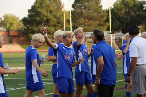 Senior midfielder Cyrus Gulati gets spirited at a game this season, making gestures at a coach. Gulati has plans to move to Germany after high school and play professional soccer in Germany.
